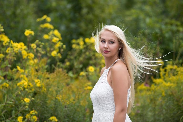 pretty Michigan High School Senior with hair blowing in the wind