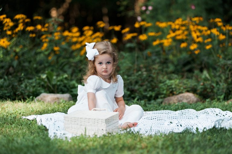 little girl in white dress with bow in her hair