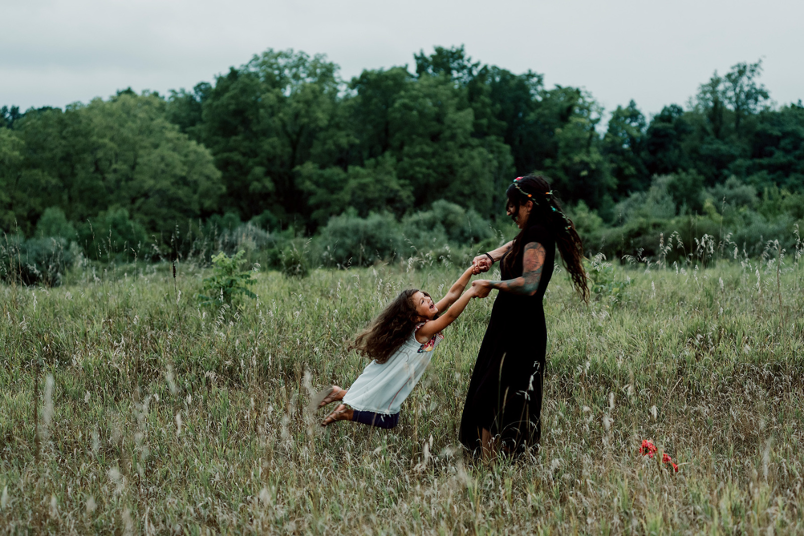 mother and child playing in field during lifestyle family photography session