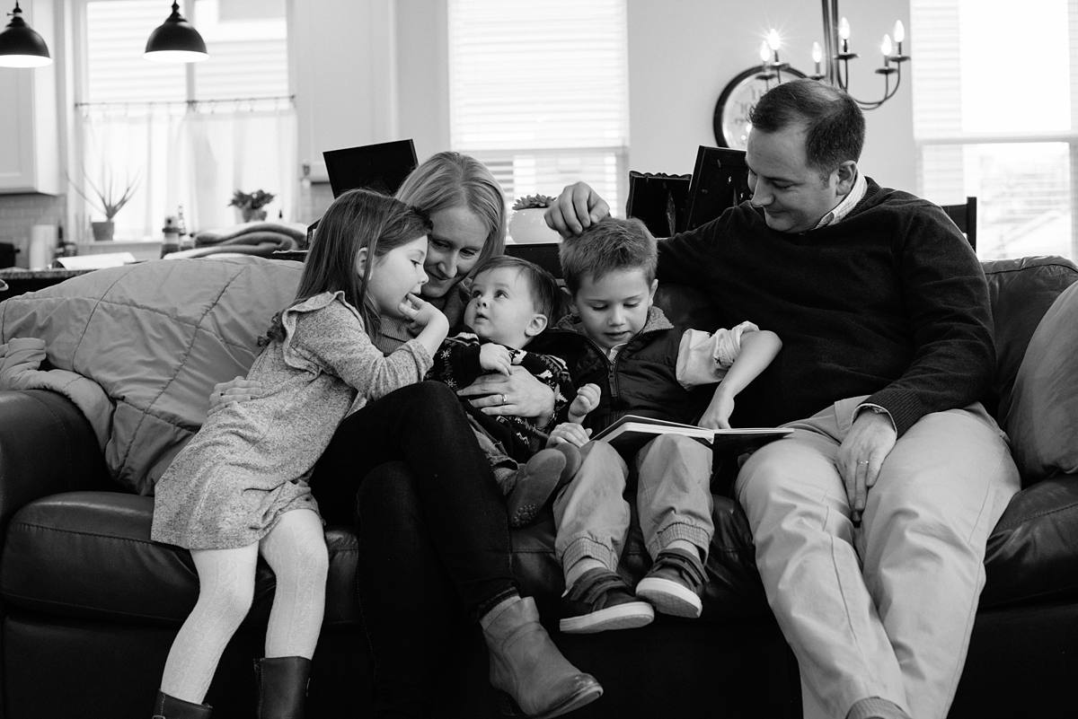 lifestyle family photography at home session reading books on couch