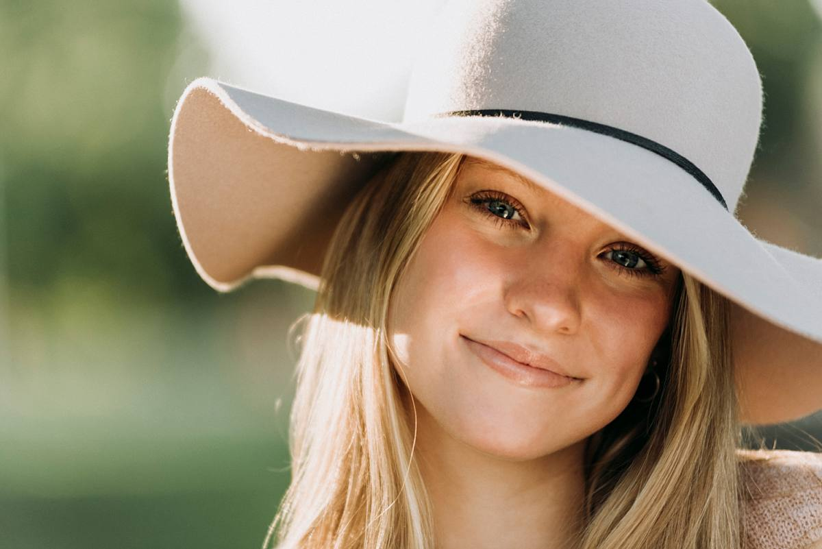 Waterford Mott Senior Pictures of girl wearing pink hat