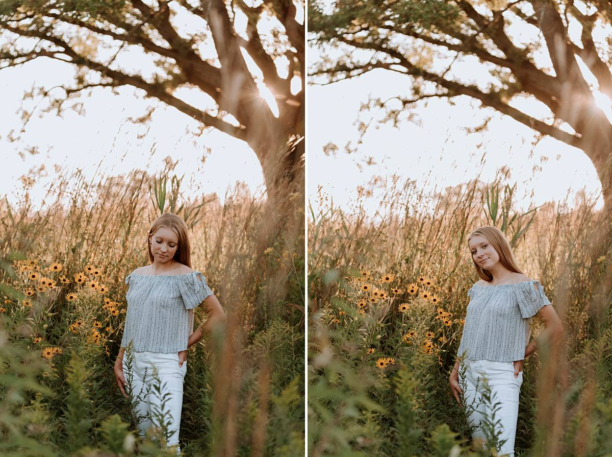 senior girl poses near large tree and sunflowers in Michigan